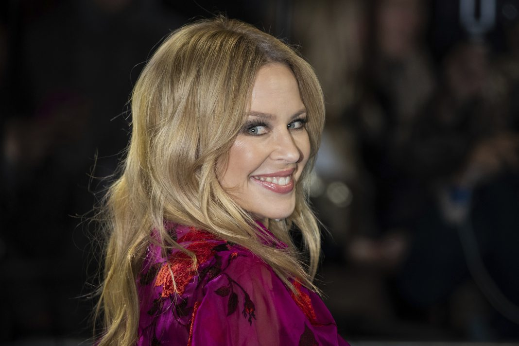 Kylie Minogue is moving from the UK back to Australia and says she can't believe the reaction. (AP PHOTO)